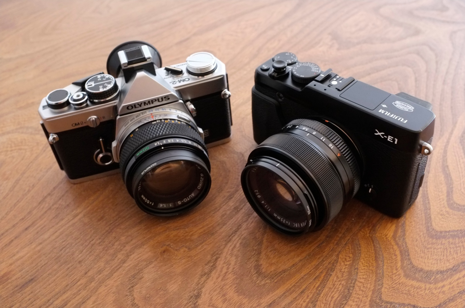 My two favourite cameras - the Olympus OM-2n and Fujifilm X-E1